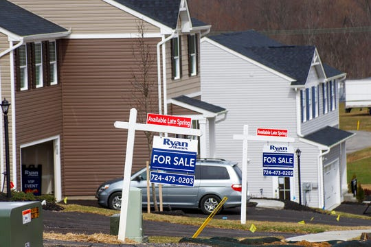 Model homes and for sale signs line the streets as construction continues at a housing plan in Zelienople, Pa., Wednesday, March 18, 2020. U.S. home sales jumped in February to their highest level in 13 years, a trend that will almost certainly be reversed as the viral outbreak keeps more people at home.