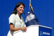 In this June 10, 2011 file photo former South Carolina Gov. Nikki Haley speaks during the dedication of Boeing Co.'s $750 million final assembly plant in North Charleston, S.C.  Haley has resigned, Thursday, March 19, 2020, from the board of Boeing Co., cutting ties with a company she long supported as South Carolina governor because of her opposition to a bailout of the airplane manufacturer that is in the works amid the growing coronavirus outbreak.