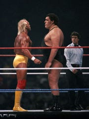 Hulk Hogan and Andre the Giant lock eyes before their main-event match at WrestleMania III.