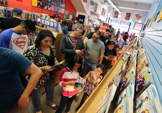 People looks at comic books during Free Comic Book Day at Chimera's Comics in La Grange, Ill. on Saturday, May 2, 2015.