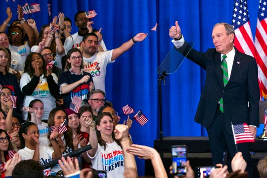 Former Democratic presidential candidate Mike Bloomberg gestures to supporters as he announces the suspension of his campaign and his endorsement of former Vice President Joe Biden for president in New York Wednesday , March 4, 2020.