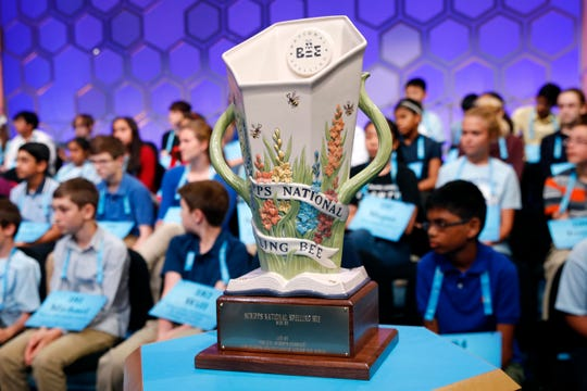 The Scripps National Spelling Bee trophy sits in front of competitors in Oxon Hill, Md. on May 28, 2019.