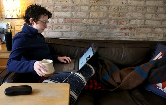 Glitch.com software engineer Melissa McEwen, 33, works from her Logan Square neighborhood home on March 12, 2020. McEwen has worked remotely for five years.