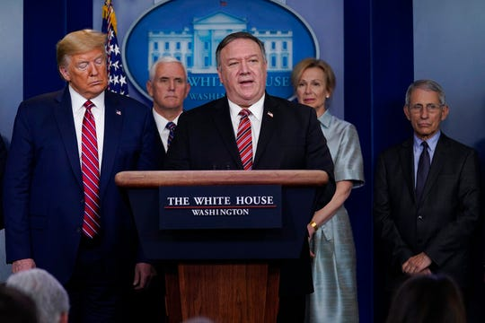 President Donald Trump listens as Secretary of State Mike Pompeo speaks during a coronavirus task force briefing at the White House, Friday, March 20, 2020, in Washington.