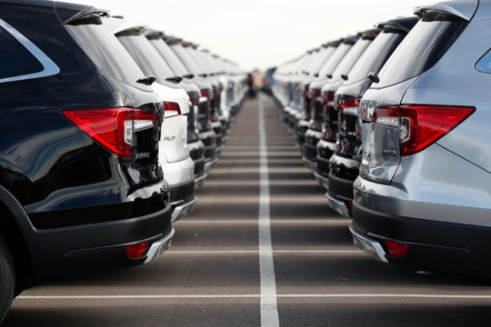 Automakers are offering big incentives as dealerships worry about the coronavirus outbreak.