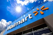 Walmart, the nation's largest retailer, said late Thursday that it plans to hire 150,000 U.S. hourly workers for its stores and distribution centers through the end of May