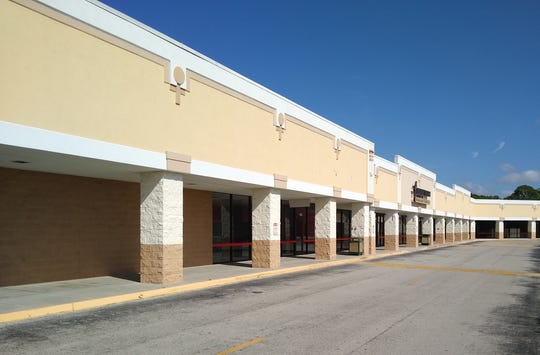 Row of stores at Merchants Crossing in North Fort Myers. The stores will be razed, along with a building that once housed Sears and the Home Depot, to make room for housing that will be part of the shopping center complex.
