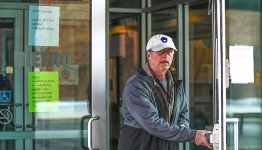 Jerry Keiler leaves the Green Bay Metro Transportation Center building after voting Friday  in Green Bay.