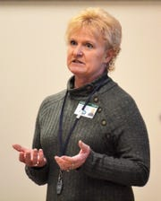 Deb Konitzer, Oconto County Public Health Officer, speaks to Oconto County Board members on Thursday, March 19.