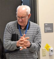 Oconto County Board member Al Sleeter rubs hand sanitizer in as he enters the Law Enforcement Center Conference Room for the Oconto County Board of Supervisors meeting on Thursday, March 19. Anyone attending the meeting was required to use the gel before going inside.