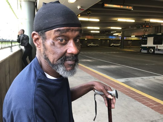 John Lloyd waits for his bus at Greenlink's Transit Center.
