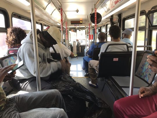 Passengers sit on a Greenlink bus Friday.