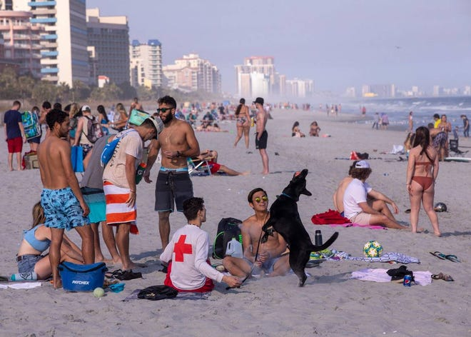 With government officials warning people to take caution and self quarantine, over a hundred college students were partying on 65th Avenue North in Myrtle Beach on Thursday. March 19, 2020.