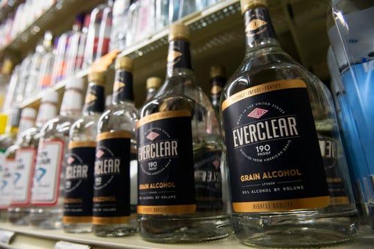 Bottles of Everclear sit on the shelves at Poinsett Liquors in Greenville Thursday, Mar. 19, 2020.