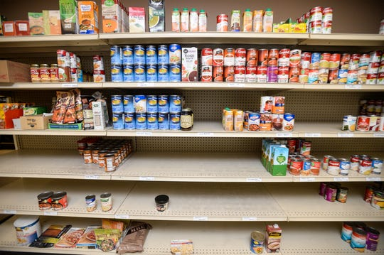 A couple shelves at the Great Falls Food Bank's food pantry where high demand items like ready to eat chili and Progresso and Campbell's Chunky soups are stocked now stand bare, Friday, March 20, 2020.  Warehouse mangager Doug Perrien says more is on the way, but panic shopping has also made it harder to find some food items that they usually have in stock.