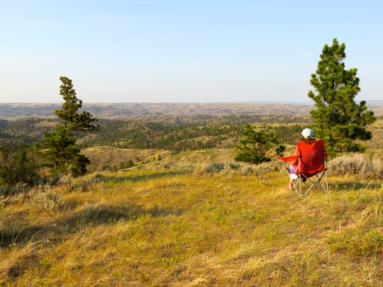 A hiker stops to enjoy the view in the Missouri River Breaks
