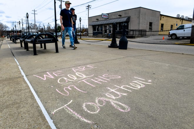 Walkers downtown are greeted with some quotes and sayings after a group of local ladies spent time writing and drawing inspirational art on the sidewalks downtown and along the Riverwalk just to brighten people's day Friday.