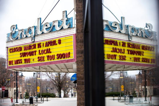 """The marquee at the Englert Theatre reads, """"Support Local"""" and """"We miss you - see you soon!"""", Friday, March 20, 2020, in Iowa City, Iowa."""