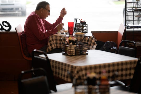 A patron who wished not to speak eats a meal at Colonel's Cafe on Newcom Ave. in Knoxville, Tennessee on Friday, March 20, 2020. Business at the restaurant has been slow but many customers could be seen leaving with to-go meals.