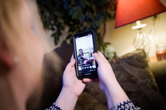 A photo illustration shows an Instagram livestreams of local Knoxville musicians Kelsi Walker and Haley Labelle in Knoxville, Tennessee on Thursday, March 19, 2020.