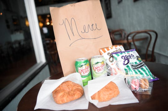 A care package offered by The French Market for those who lost or are struggling in their service sector jobs includes two drinks, two bags of chips, two croissants and macaroons in Knoxville, Tennessee on Friday, March 20, 2020. Those who are eligible may pick up a care package between 11am and 3pm at the downtown location.