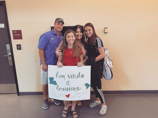 Marina Simoes (right), 16, is an exchange student from Brazil attending Southside High in Youngsville this year. Her host family picked her up from the airport in August with signs welcoming her to Louisiana in Portuguese. With Marina are Whitney, Tabitha and Emma Kate Rogers.