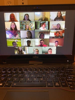Students in Advanced Placement English at St. Thomas More Catholic High School have class through Zoom, an online video conferencing program, Friday, March 20, 2020.