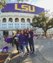 Marina Simoes, 16, is an exchange student from Brazil attending Southside High in Youngsville this year. Her host family, Whitney, Tabitha and Emma Kate Rogers, took her to an LSU football game.
