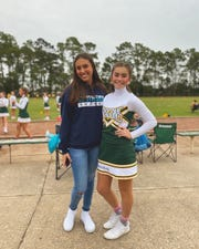 Marina Simoes (right), 16, is an exchange student from Brazil attending Southside High in Youngsville this year. Here she takes a picture with her host sister Emma Kate Rogers, a cheerleader at Youngsville Middle School.