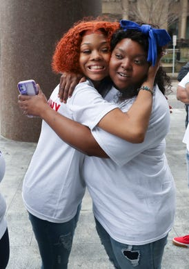 Bianca Austin, right, embraced her niece Juniyah Palmer during a vigil for her other niece, Breonna Taylor, outside the Judicial Center in downtown Louisville, Ky. on Mar. 19, 2020.  Taylor was shot and killed by LMPD officers last week. The family chose the vigil site because it is across the street from the Louisville Metro Police Department.