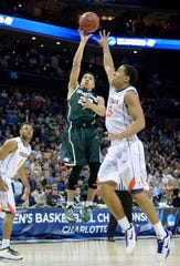 Travis Trice #20 of the Michigan State Spartans shoots over Malcolm Brogdon #15 of the Virginia Cavaliers during the third round of the 2015 NCAA Men's Basketball Tournament at Time Warner Cable Arena on March 22, 2015 in Charlotte, North Carolina.