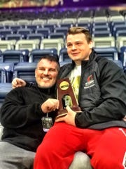 Otterbein head coach Brent Rastetter with Drew Kasper after he finished fifth in the 2019 NCAA Division III Wrestling Championships