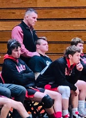 Otterbein coach Brent Rastetter and star wrestler Drew Kasper watch the team in action this winter. They've known each other since Rastetter was the varsity coach at Lexington and Kasper was a second grader wrestling in the biddy program.