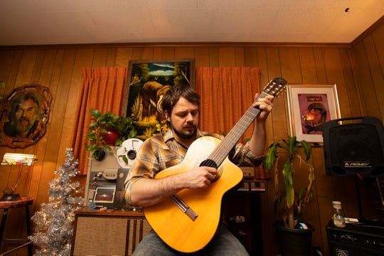 Musician Graham Winchester in his Midtown home studio on Friday, March 20, 2020. Winchester, who performs and supports himself and his young family as a musician and tour guide at Sun Studio, is now acclimating to the realities of losing all his gigs and his day job during the coronavirus pandemic. To balance out his time away from music venues, he has started livestreaming his performances from home with musician friends to promote his latest work.