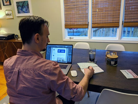 RedRover creative director Jesse Lorencz works from home in East Lansing, Michigan. The Memphis marketing and sales agency began its first full remote work day on Wednesday in response to the COVID-19 pandemic.