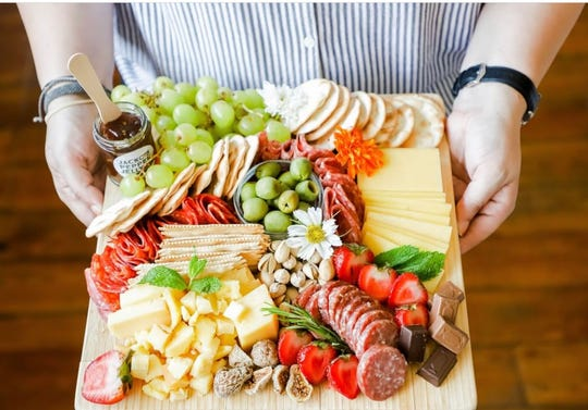 A charcuterie and cheese board by Feast & Graze, a catering company in Memphis.