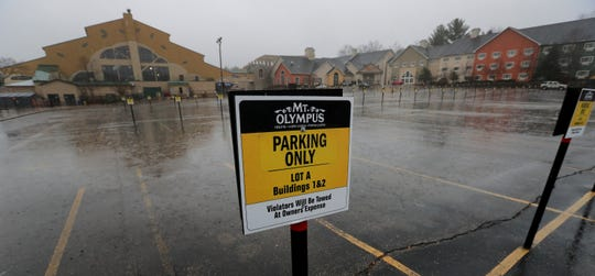 The main parking lot at Mount Olympus Resorts is shown March 19, 2020, in Wisconsin Dells. All of the waterparks in the Wisconsin Dells area and most of the hotels are closed.
