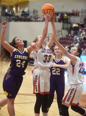 Norfork's Kiley Alman and Kynzie Rangel battle Concord players for a rebound during state tournament play at Lake Hamilton High School.