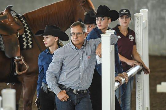Auburn equestrian coach Greg Williams looks on during a meet.