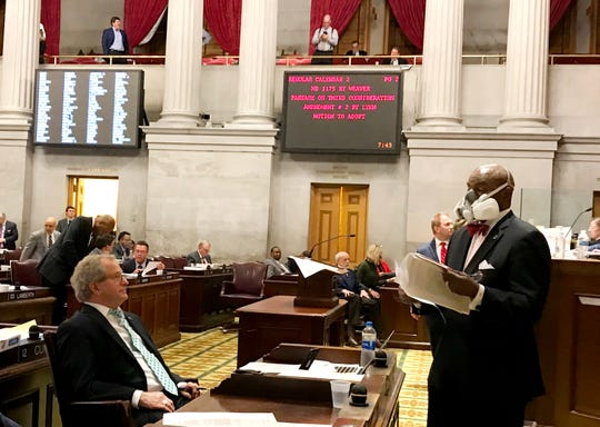 Rep. G.A. Hardaway, D-Memphis, talks with Rep. Mark White, R-Memphis, on the floor of the House on March 19, 2020, the final night before lawmakers recess amid the ongoing COVID-19 pandemic.