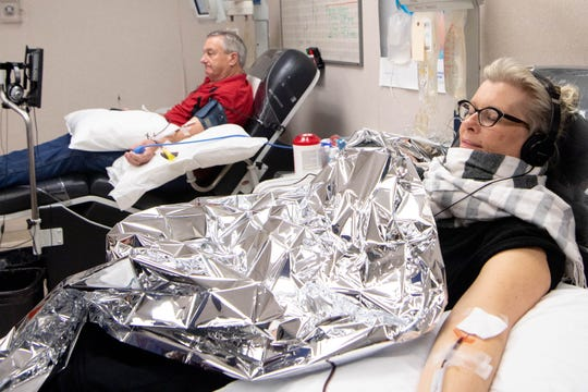 Tony Perkerson, left, and Kwyn Bridges donate blood at the American Red Cross Friday, March 20, 2020, in Nashville, Tenn. Due to the coronavirus, many blood drives were canceled, however Red Cross still needs volunteers.