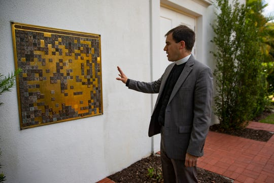 Rev. Nicholas Caccese, an associate rector at Trinity by the Cove Episcopal Church, shows the layout of their Memorial Garden at his church, Trinity by the Cove Episcopal Church in Naples on Friday, March 20, 2020.