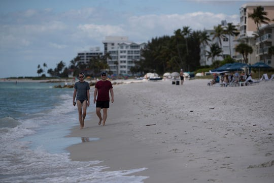Community members and tourist spend time on the beach, Friday, March 20, 2020, in Naples.