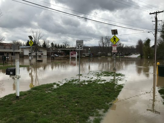 Another view of a flooded South Main Street in Granville on Friday afternoon.