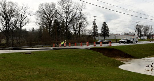 A section of Ohio 79 collapsed after flash flooding hit the area near Heath on Friday morning.