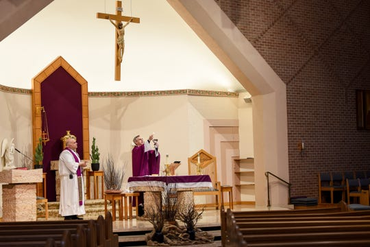 Saint Elizabeth Church in Wyckoff, NJ offers a livestream of prayer services on Friday March 20, 2020. (From left) Parochial Vicar Vincent D'Agostino and Pastor Stephen Fichter lead the mass in an empty church due to coronavirus.