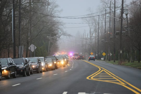 A line of cars along Paramus Rd waiting to enter the Bergen County Community College to be tested for Covid-19 in Paramus, N.J. on Friday March 20, 2020. Members of the N.J. National Guard and law enforcement agencies are in the area for the FEMA testing site.