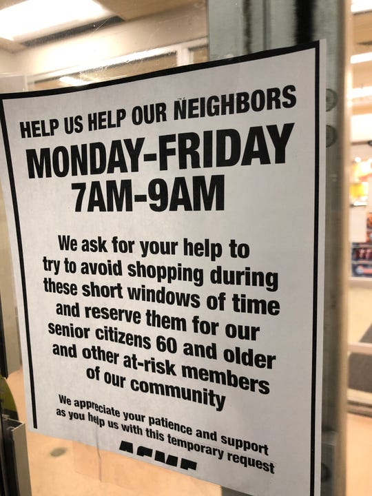 A sign on an entrance to the Acme supermarket in West New York describing priority shopping hours for senior citizens during the coronavirus outbreak.