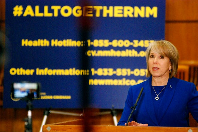 New Mexico Gov. Michelle Lujan Grisham confirmed a new coronavirus infection that has no apparent link to travel on Wednesday, March 18, 2020, during a news conference on the floor of the state House of Representatives in Santa Fe, N.M.