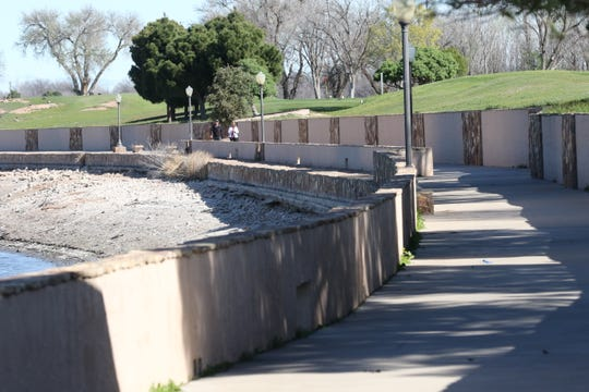 The river walk in the Lake Carlsbad beach area is largely unused as residents were asked to self quarantine amid the coronavirus pandemic, March 20, 2020 in Carlsbad.